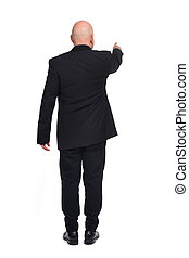 man pointing on white background