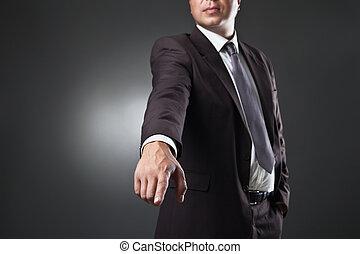 Man Points A Finger over dark. Commanding