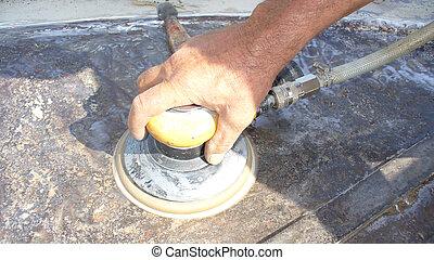 man polishing