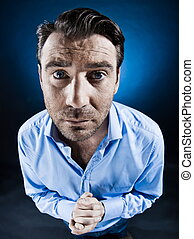 caucasian man beg desperate unshaven portrait isolated studio on black background