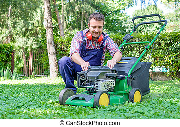 Man portrait mowing the lawn with lawnmower