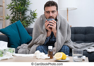 Man portrait suffering cold and flu at home