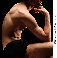 man posing - classical position of a model (black & white)