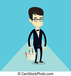 Man posing on catwalk during fashion show.