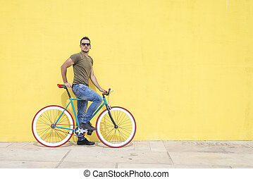 Man posing with his fixed gear bicycle