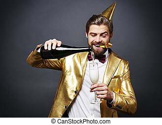 Man pouring champagne into champagne flute