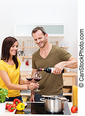 Man pouring his wife a glass of wine