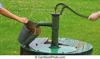 Man powered water pump at the well - Man powered water pump...