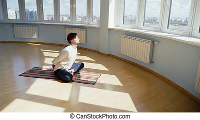 Man practice yoga. Young attractive male doing breathing ...