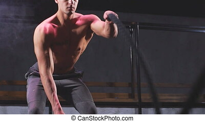 Man practices Battle Rope Exercise, great for improvement of...