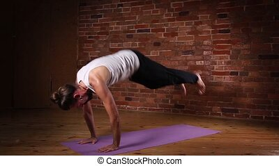 Man practicing advanced yoga - Young man practicing advanced...