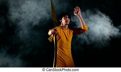 man practicing kung fu. Master holding nunchuck. Close up -...