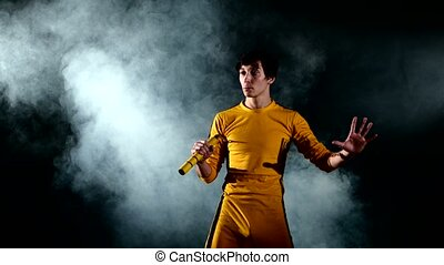 man practicing kung fu. Master holding nunchuck - The man in...
