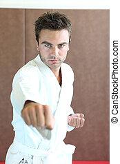 Man practicing martial arts moves