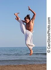 practicing martial arts on the beach