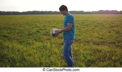 man practicing with a ball on the soccer field