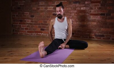 Man practicing yoga - Young man practicing advanced yoga...