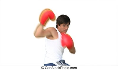 Man practising kick boxing against a white background