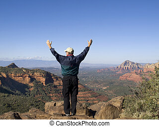 Man praising God from the mountain top