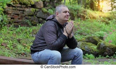 Man praying at outdoors