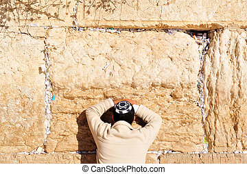 Man Praying at Western Wall - A Jewish man prays at the...