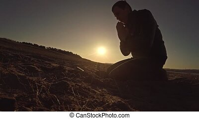 man praying god sunset sitting silhouette sun sunlight the...