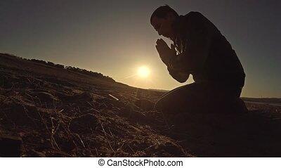 man praying god sunset sitting sun silhouette sunlight the...