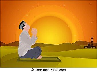 man praying on sunset background
