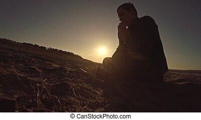 man praying sunset god sitting silhouette sun sunlight the...