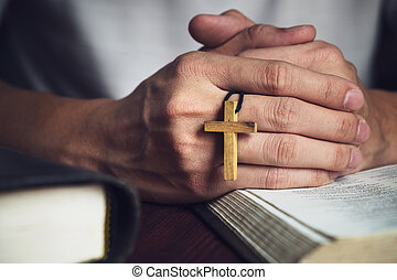 Man Praying to God with a Bible in the Morning Devotion