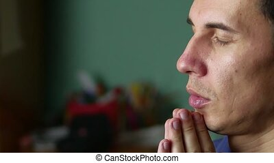 man prays to God. Christianity is a religion. prayer indoor...