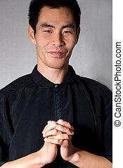 man preaching - asian looking man in preaching or praying ...