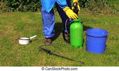 man prepare pesticide - Farmer man in protective clothes ...
