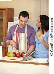 Man preparing a fruit salad