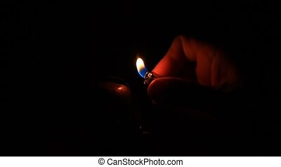 Man preparing an old fashioned lantern in darkness. How to...