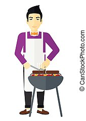 Man preparing barbecue.