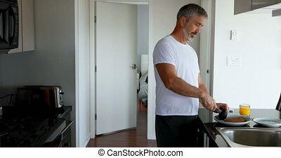 Man preparing breakfast in kitchen 4k