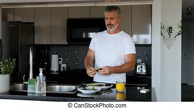 Man preparing breakfast in kitchen 4k - Man preparing...