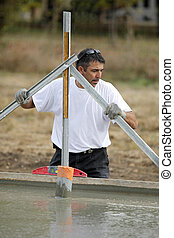 Man preparing building foundations
