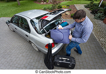 Man preparing car for a trip