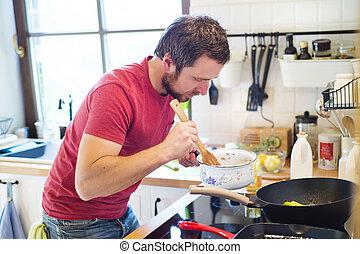 Man preparing creamy mushroom sauce