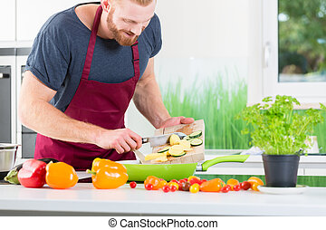 Man preparing food for cooking in kitchen