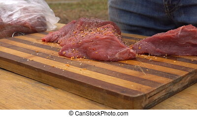 Man preparing meat for barbeque - Man preparing fresh meat...