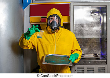 Man preparing meth - Man in protective outerwear suit sorts...