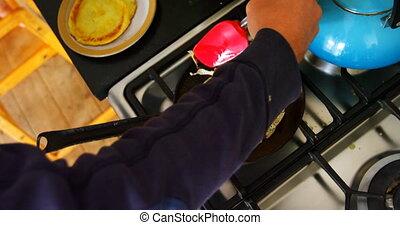 Man preparing pancake in kitchen 4k