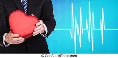 Man present heartbox beside pulse line