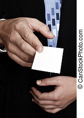 Man presenting a blank business card