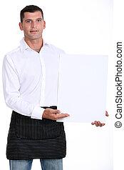 Man presenting white panel
