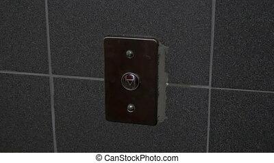 Man presses a button for an elevator - Man presses a button...