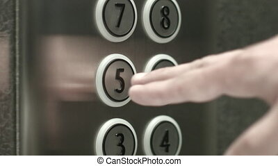 Man presses a button the fifth floor in an elevator - Man...
